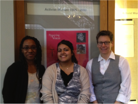 Shawnta Smith, Yasreen Ijaz, and Polly Thistlethwaite in front of the main poster