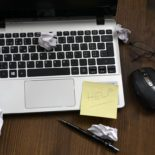 Image of a laptop with a Help Sticky Note